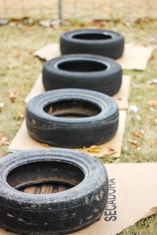 tires layed out on cardboard squares in a backyard